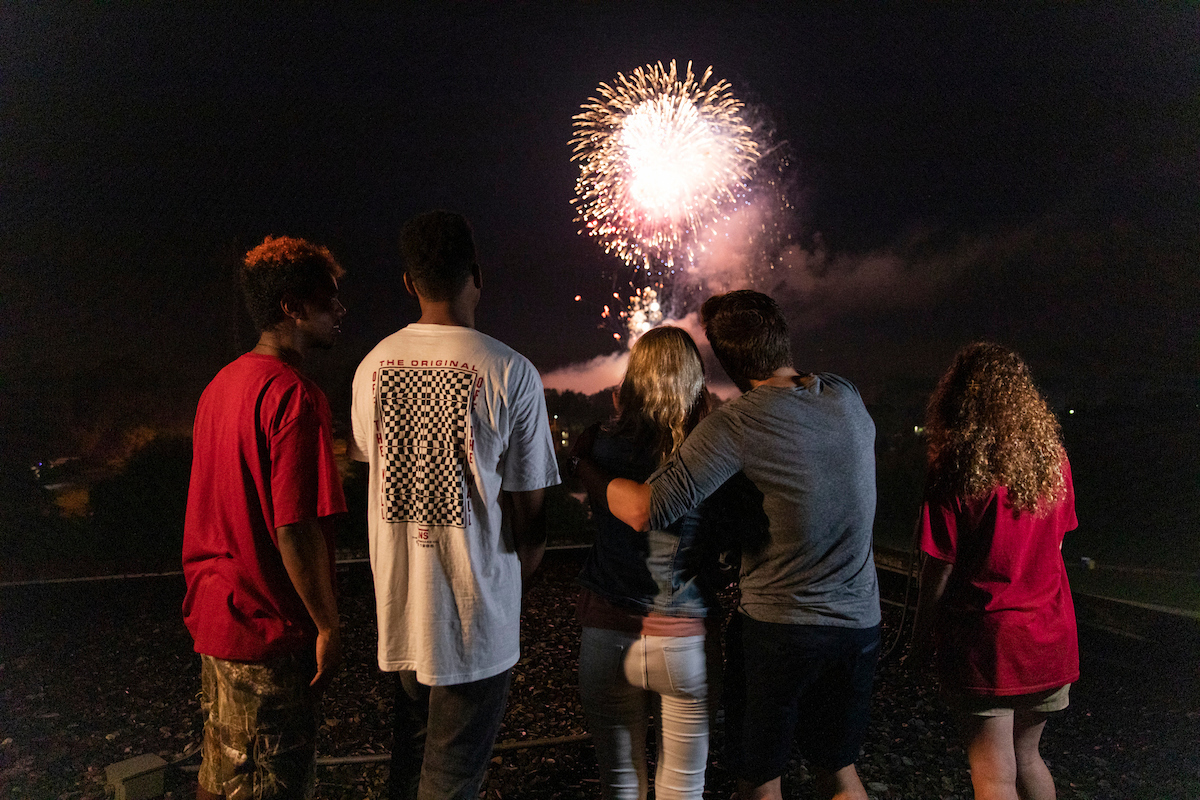 Group of students watch fireworks together.