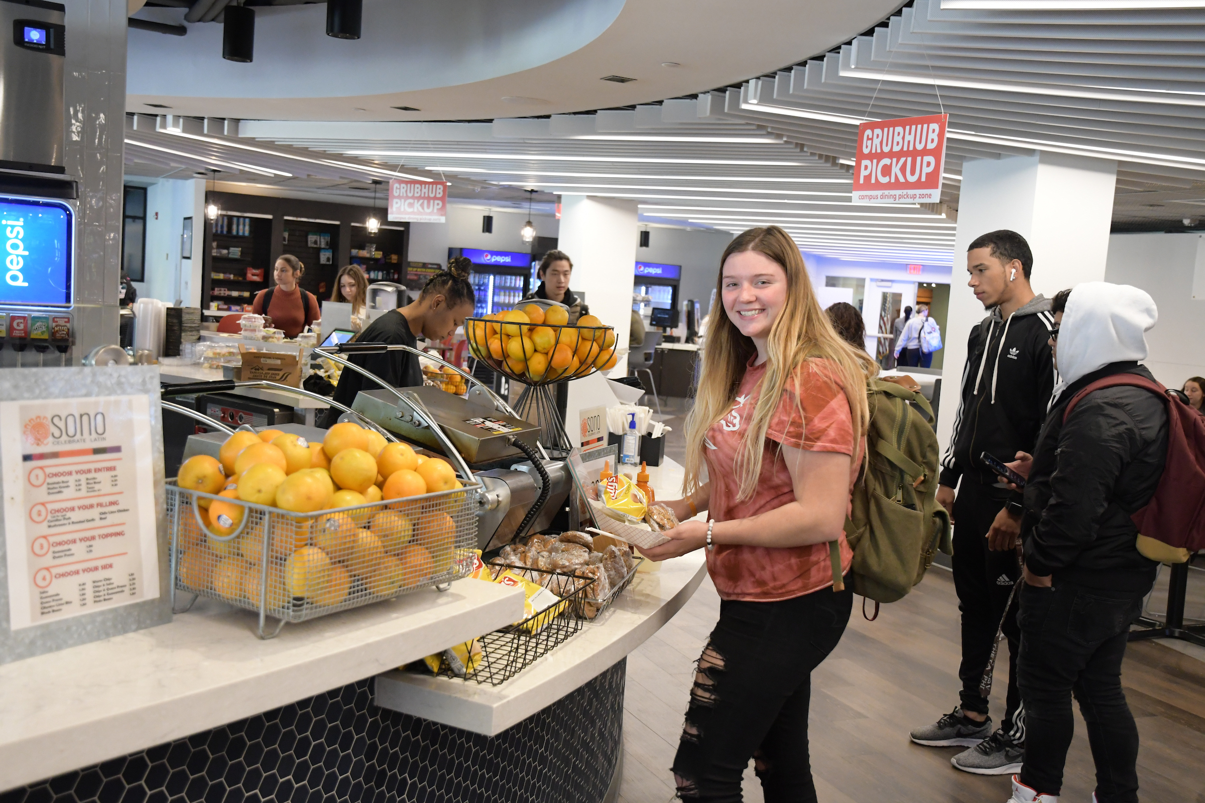 Students pick up grab-and-go meals