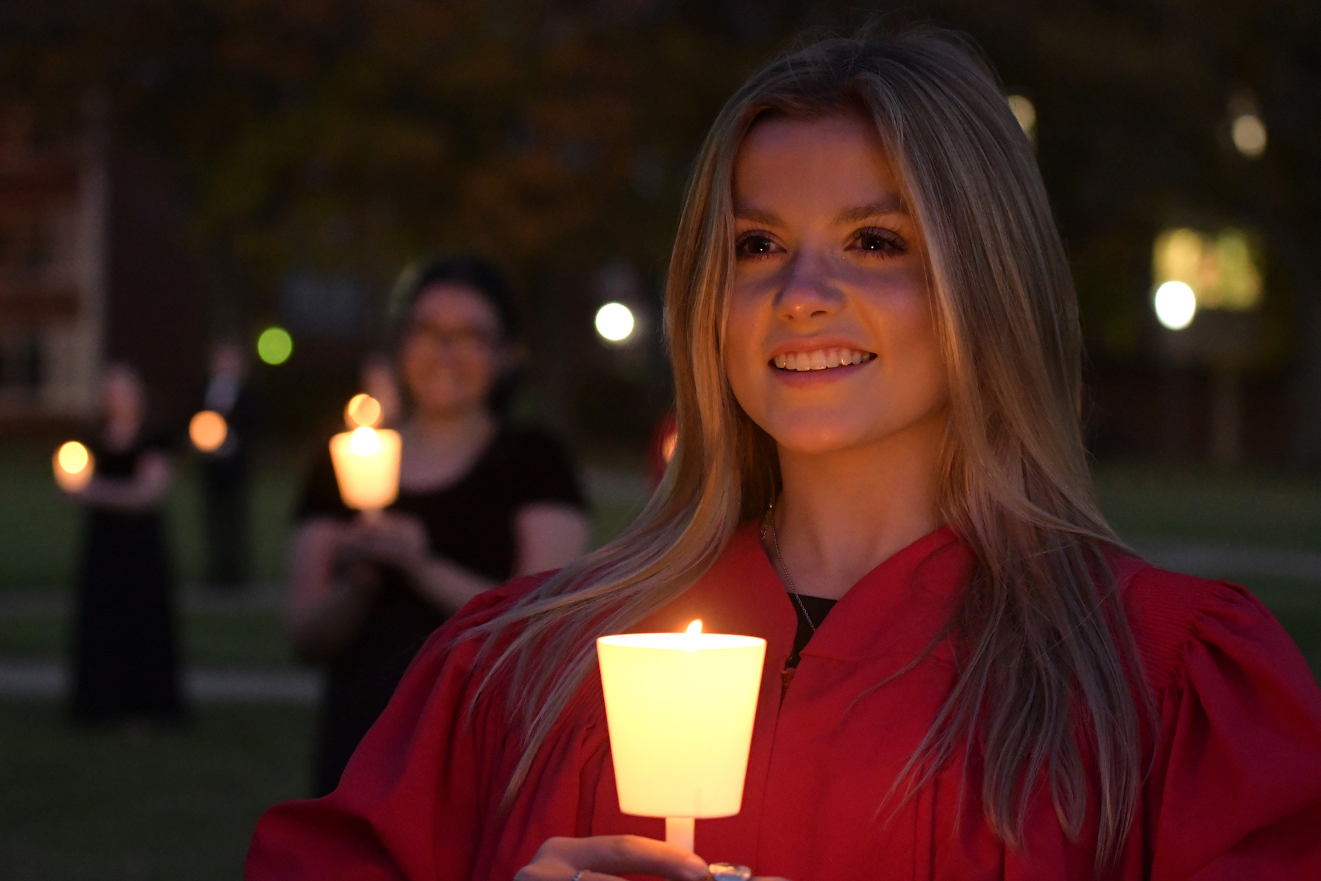 Female student holding candle