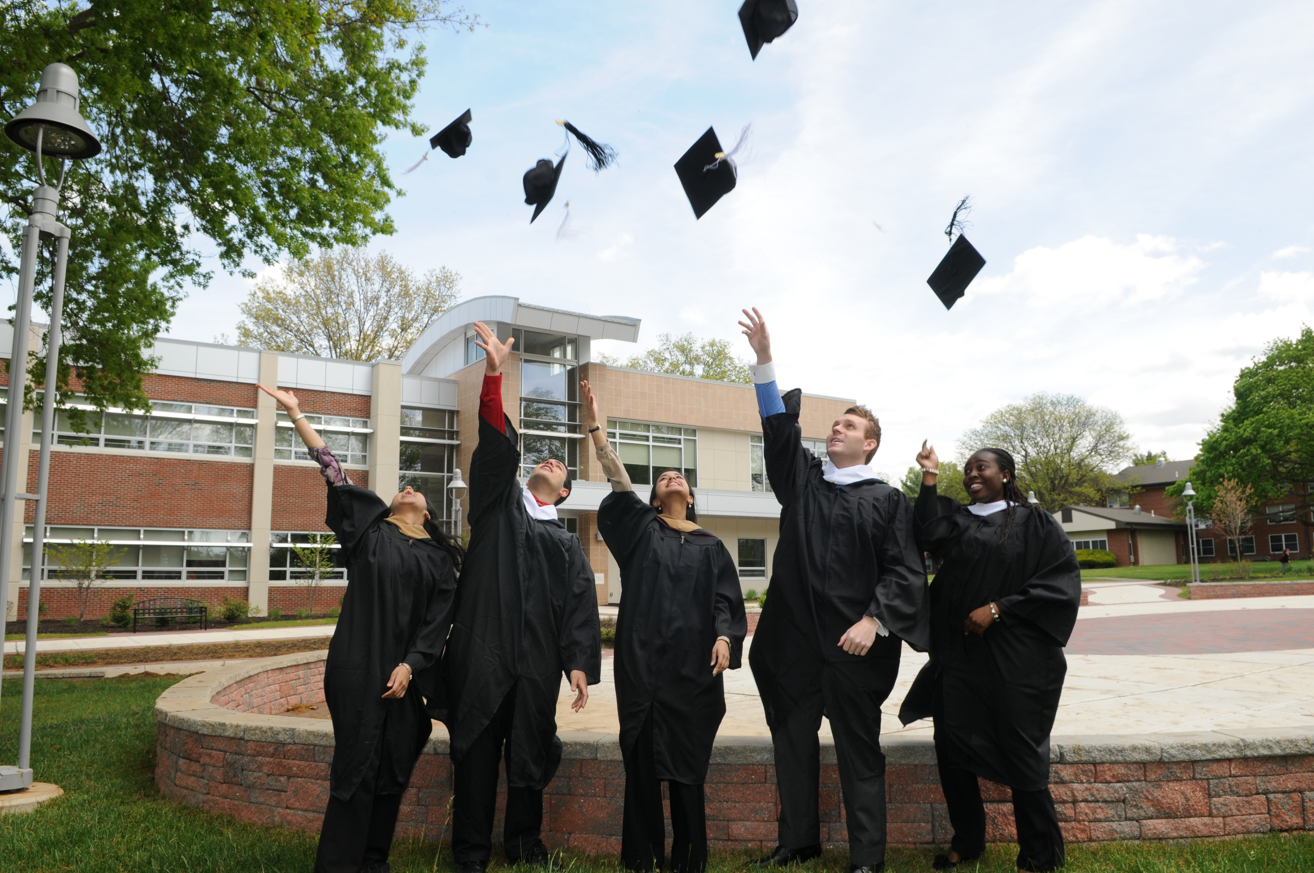 Rider graduates toss their caps at commencement