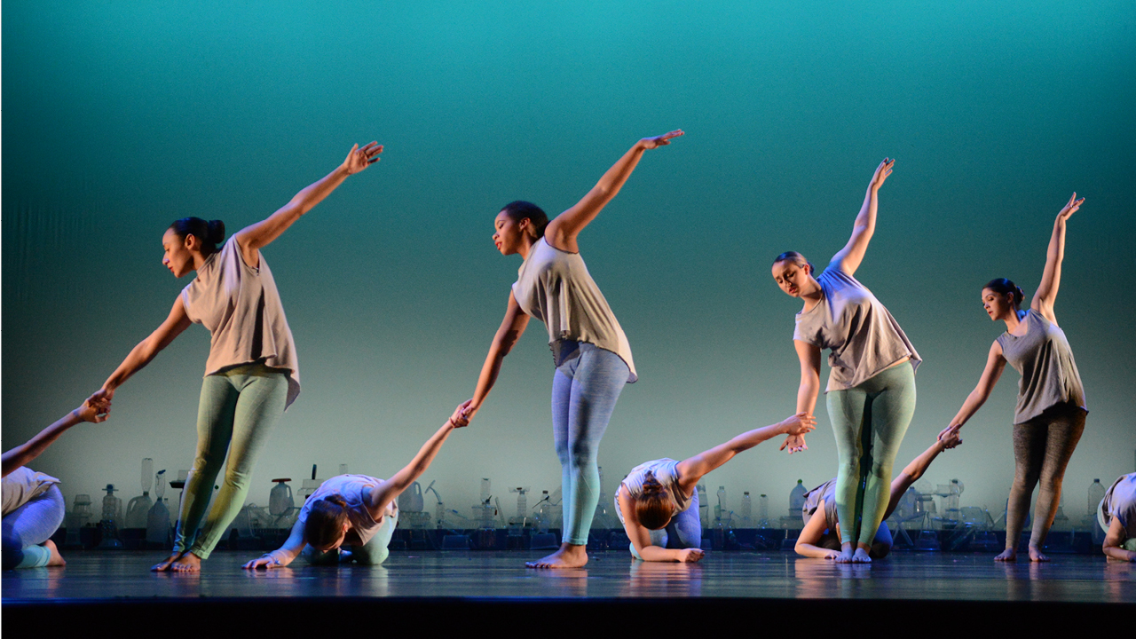 Students dance on stage