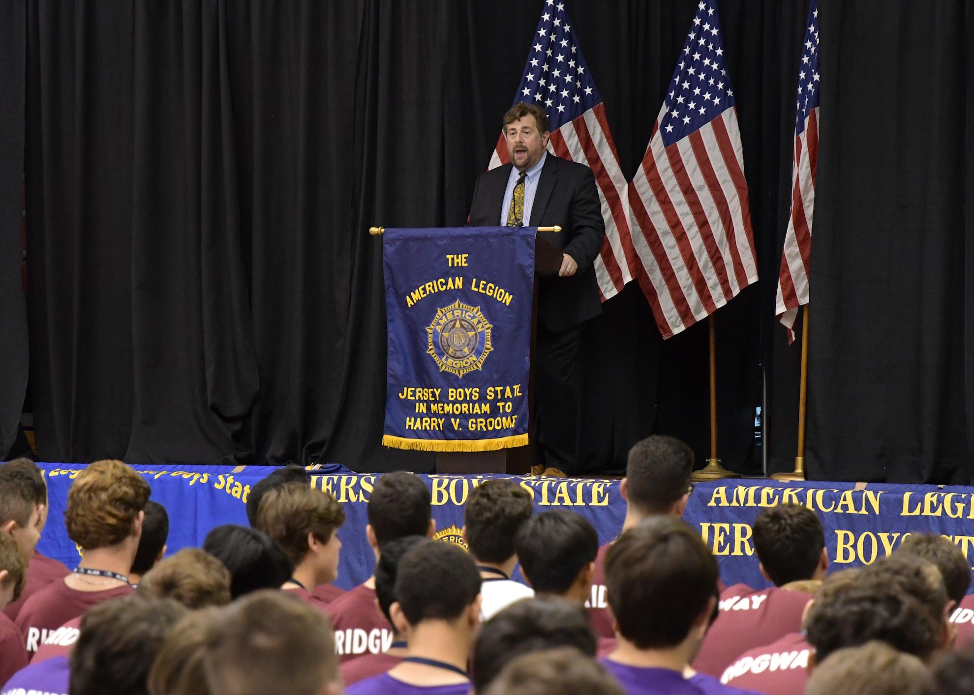 Micah Rasmussen addresses AMJBS members.
