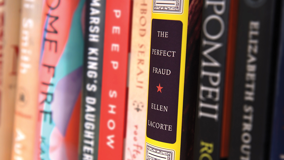 The Perfect Fraud displayed on the author's bookshelf
