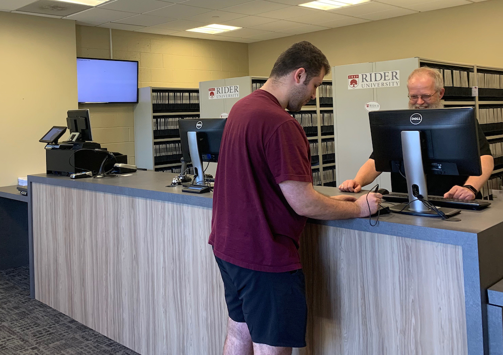 Rider student gets mail at Rider University mailroom