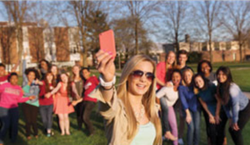 Student talking a group selfie