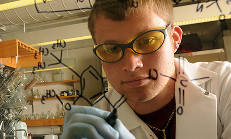 Image of student in lab, Explore majors and success stories.