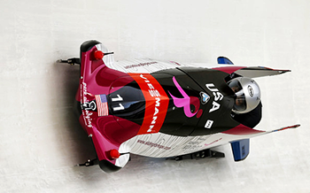 Image of Jazmine Fenlator driving sled.