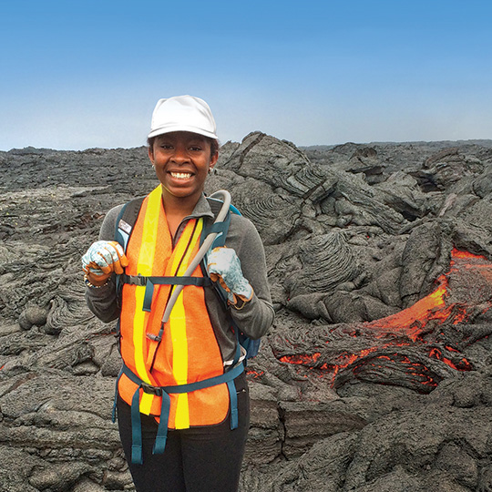 Imani Guest stands on volcanic rock.