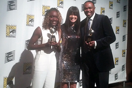 Sheena Howard poses with Kelly Hu and Ronald Jackson after winning the Eisner