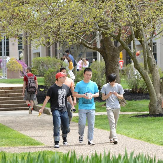A group of students walking near alumni gym
