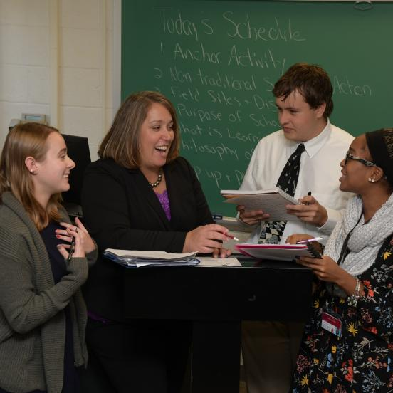 Professor Tracey Garrett speaks with education students