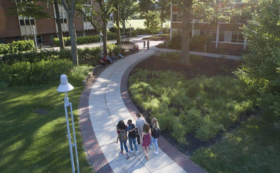 A group of students walking across campus