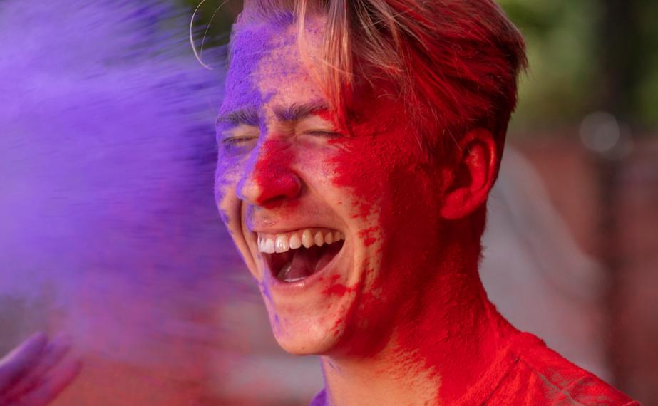 Student get's purple and red paint thrown at him.