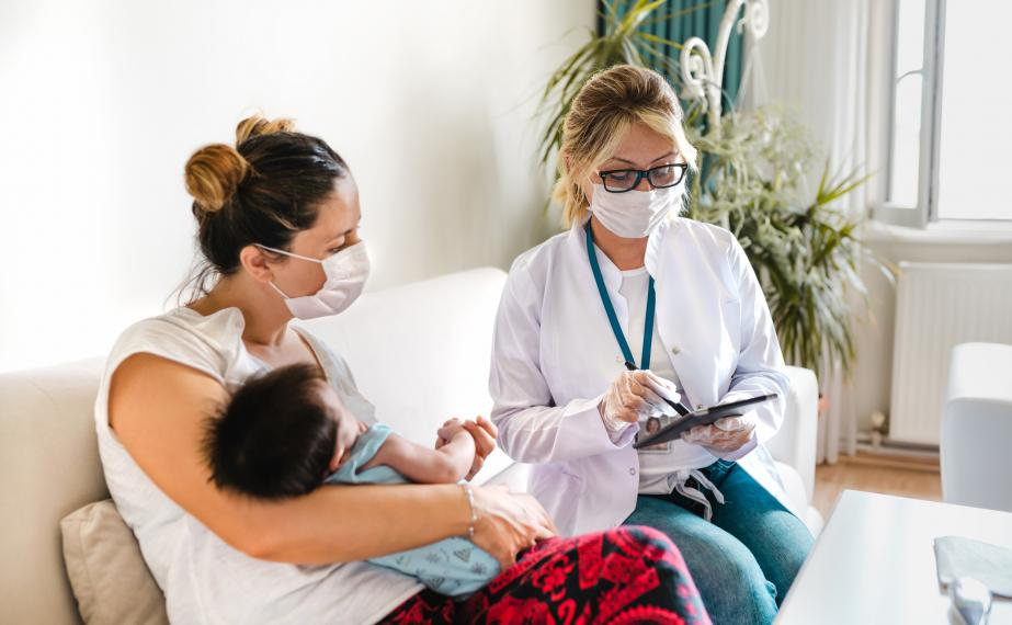 Nurse consults with mother and child