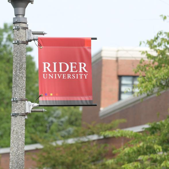 Norm Brodsky College of Business with Rider Flag
