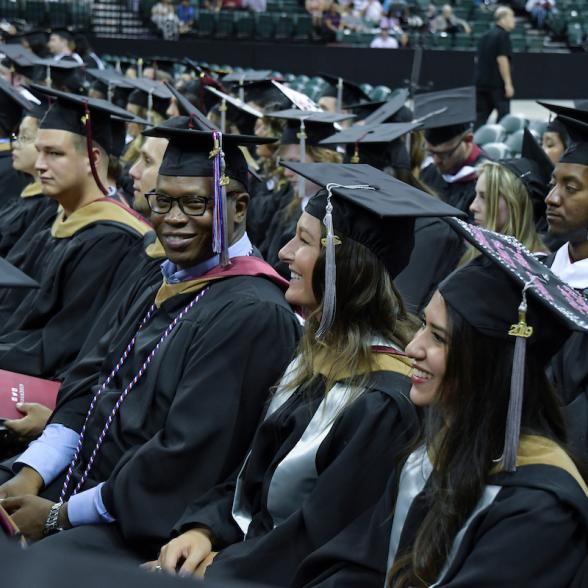 Students listen to speaker at Commencement
