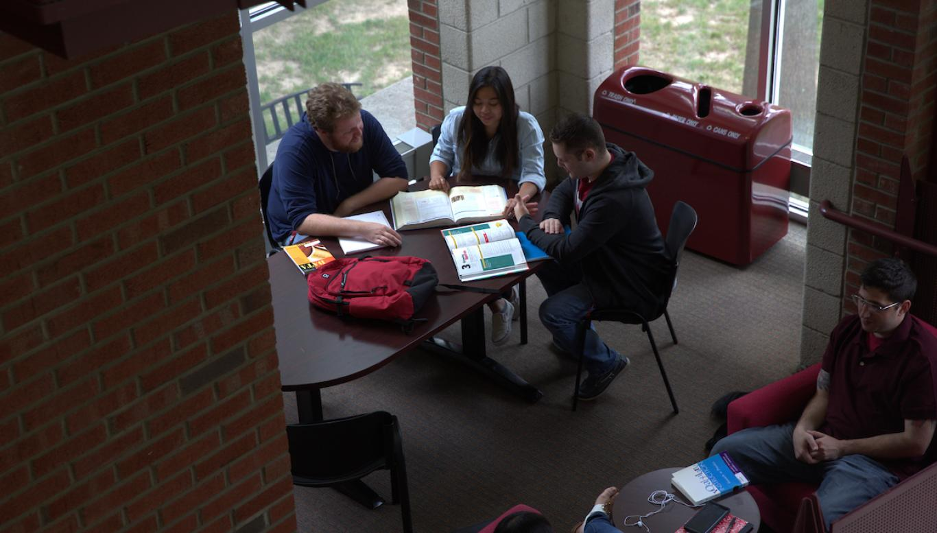 Students study together at a table