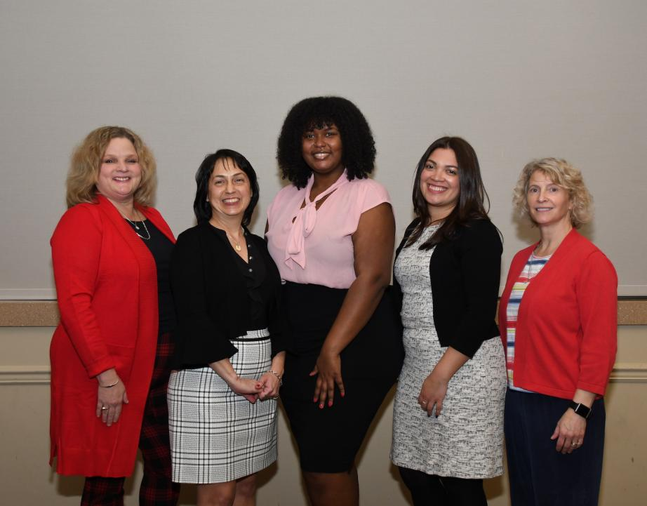 Five women pose for photo at scholarship event