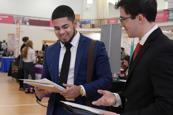 Students meet with employers at career fair