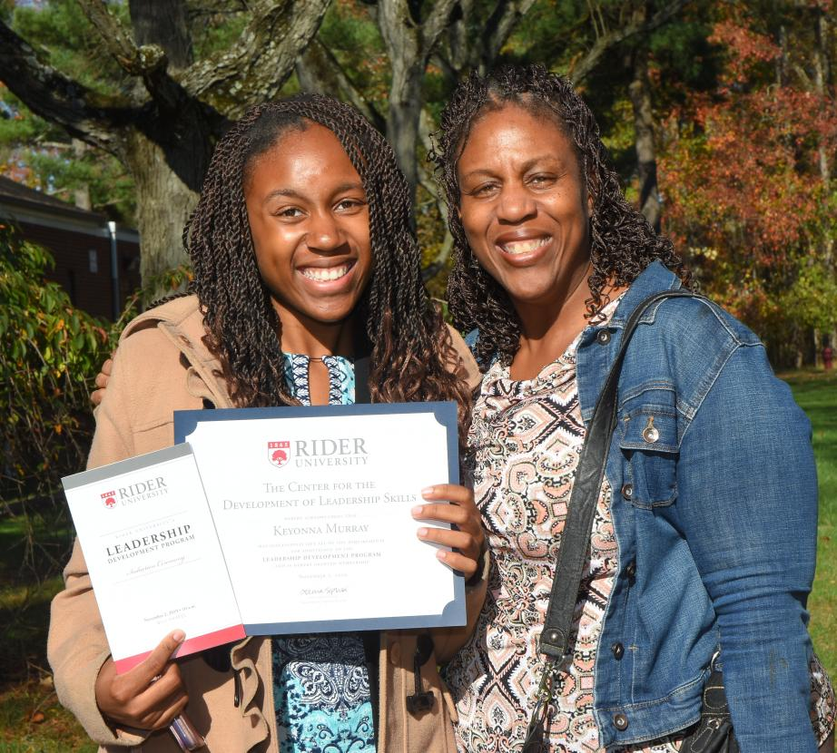 Mother and daughter celebrate her leadership skills