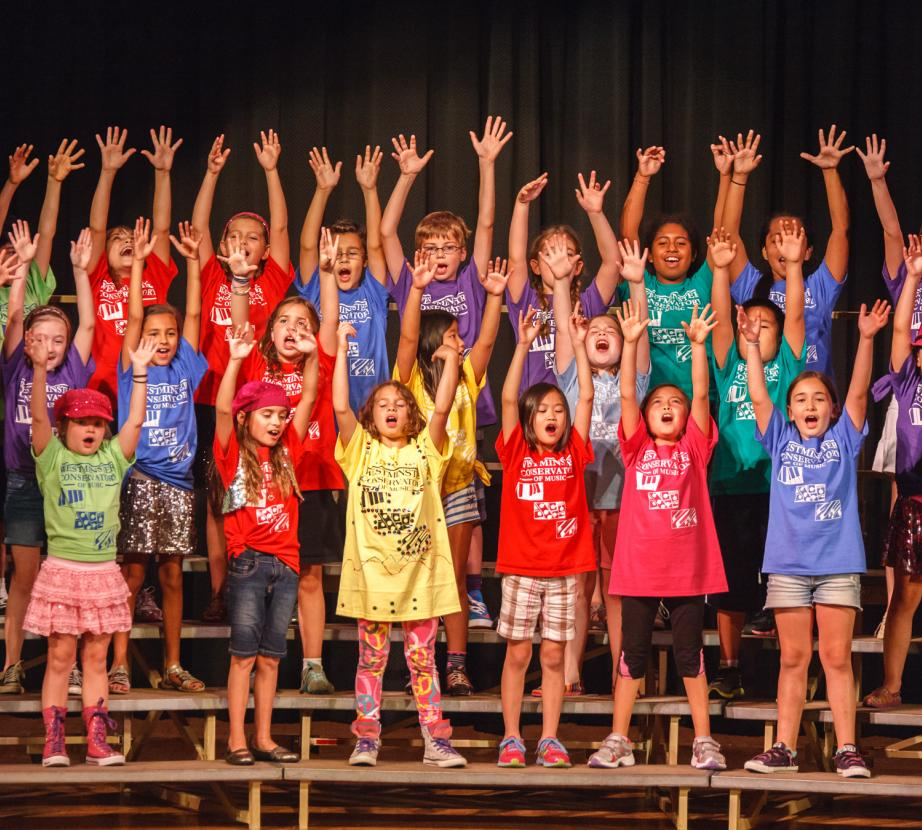 Summer Camp children reaching for the stars during a performance