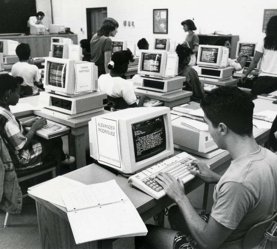 Old photo of people working on computers