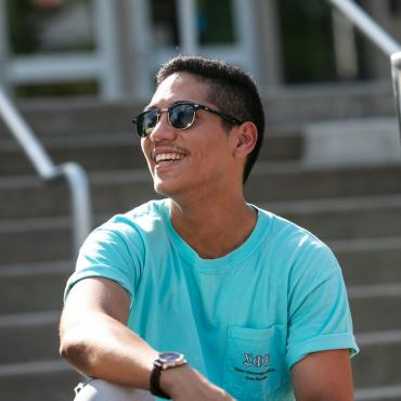 Student smiles on library steps